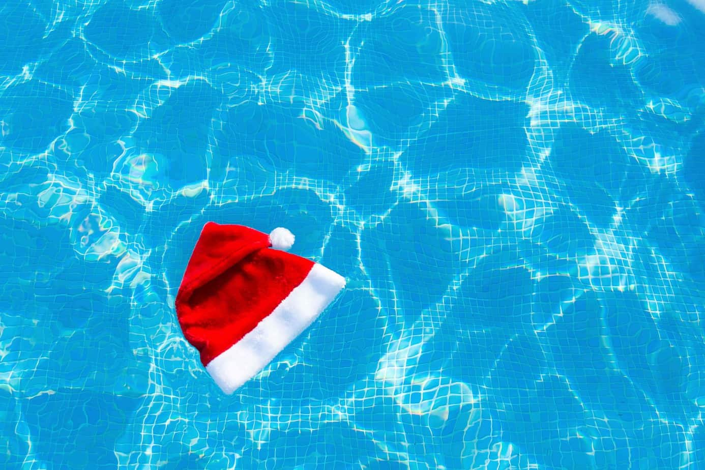 A Santa hat floating on water.
