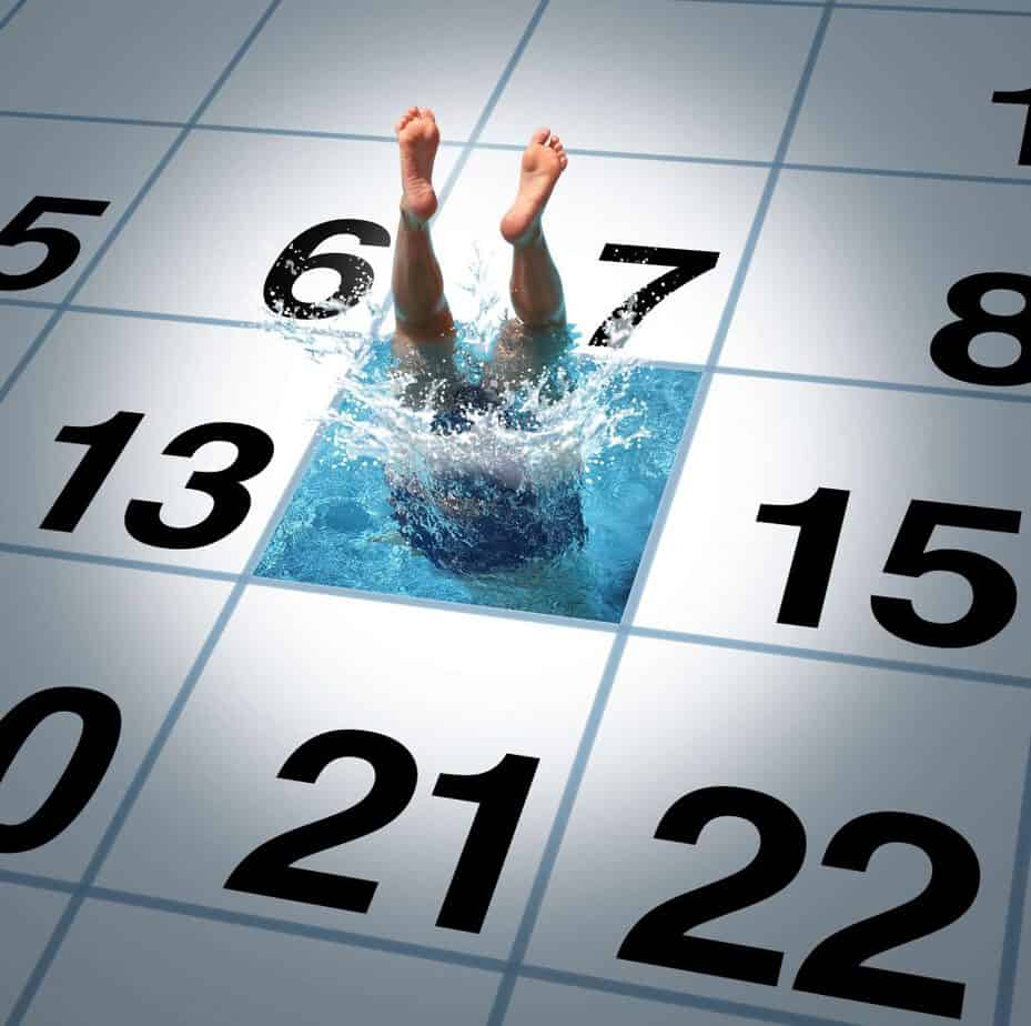 Calendar with a man diving through water on day 14.