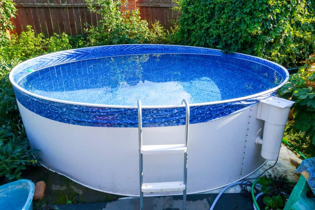 An above ground pool that is not completely level.  Water